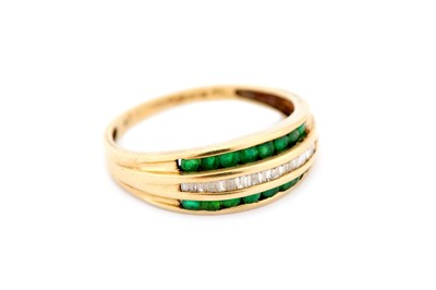 Lot 24-Two emerald-set rings, the first set with three...