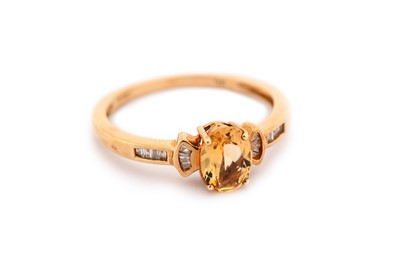 Lot 19-A topaz and diamond ring, the oval-cut orange...