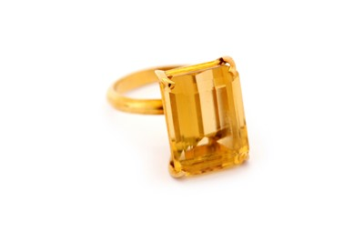 Lot 18-A citrine single-stone ring, set with a...