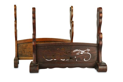Lot 9-TWO SWORD STANDS. 20th Century. A dark wood...