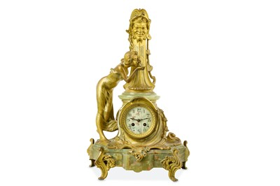 Lot 35-AN EARLY 20TH CENTURY ART NOUVEAU STYLE GILT BRONZE AND ONYX FIGURAL MANTEL CLOCK 'LA SOURCE'