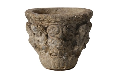 Lot 9-AN EARLY MEDIEVAL CARVED STONE MORTAR OR VESSEL DECORATED WITH GROTESQUES
