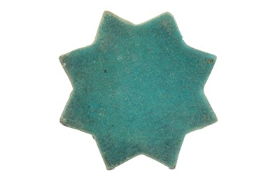 Lot 3-A TURQUOISE-PAINTED STAR POTTERY TILE PROPERTY OF THE LATE BRUNO CARUSO (1927 - 2018) COLLECTION