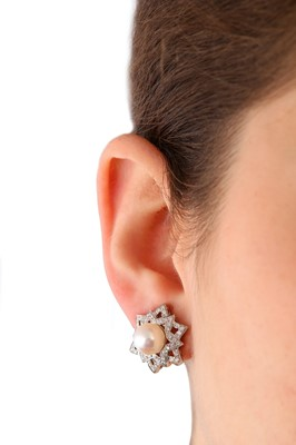 Lot 45-A pair of cultured pearl and diamond earclips