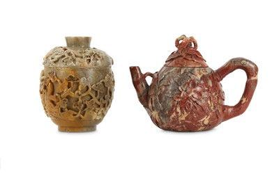 Lot 66 - A CHINESE SOAPSTONE 'MAGNOLIA' TEAPOT AND COVER AND A SOAPSTONE 'GRAPEVINE' CUP AND COVER.