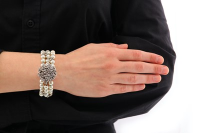 Lot 10-A cultured pearl and diamond cocktail watch, circa 1985