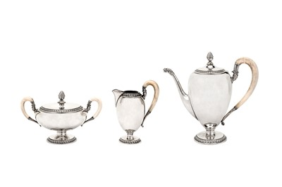 Lot 248-An early 20th century German sterling silver three-piece coffee set, circa 1930 makers mark a Key retailed by Gebruder Weyersberg of Dusseldorf (est. 1902)