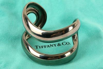 Lot 121-A blackened silver cuff, by Elsa Peretti for Tiffany & Co.