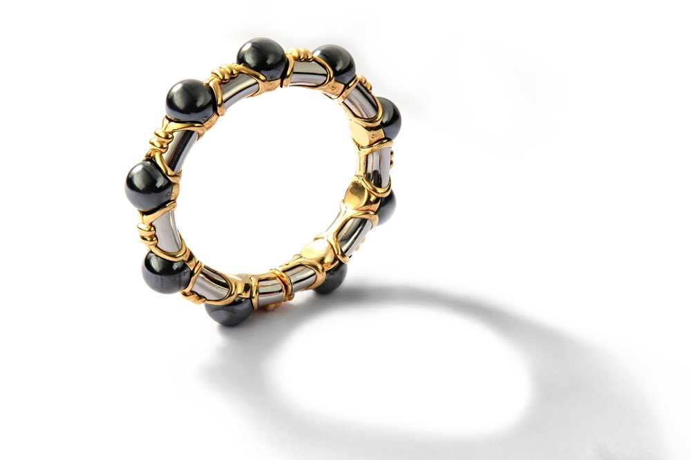 Lot 32-A 'Tubini' bangle, by Bulgari