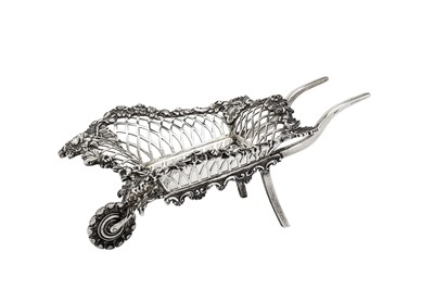 Lot 221-An Edwardian sterling silver novelty bon bon wheelbarrow, London 1908 by Goldsmiths and Silversmiths