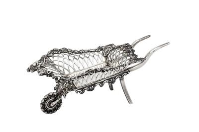 Lot 11-An Edwardian sterling silver novelty bon bon wheelbarrow, London 1908 by Goldsmiths and Silversmiths