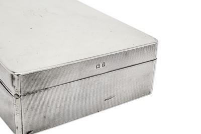 Lot 38-A George V sterling silver cigarette box, Birmingham 1914 by William Neale & Son
