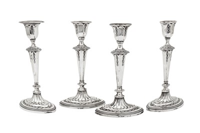 Lot 386 - A set of four George V sterling silver candlesticks, Sheffield 1910 by James Deakin & Sons