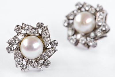 Lot 8-A pair of cultured pearl and diamond earrings