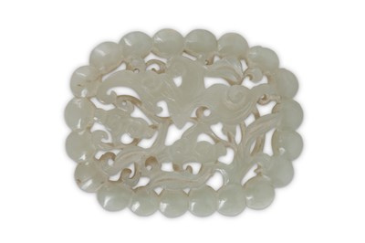 Lot 54 - A CHINESE PALE CELADON JADE RETICULATED 'BAT' PLAQUE.