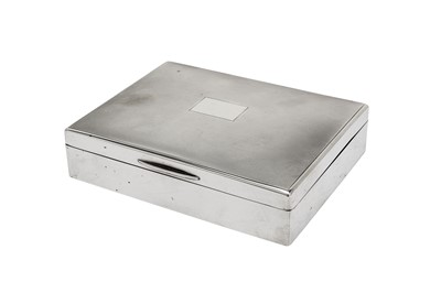 Lot 9-A George VI sterling silver cigarette box, London 1937 by Mappin and Webb