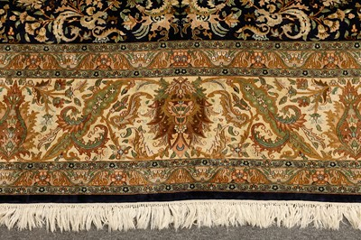 Lot 22-AN EXTREMELY FINE LARGE SILK INDIAN CARPET