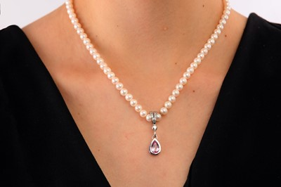 Lot 16-A cultured pearl, pink topaz and diamond pendent necklace