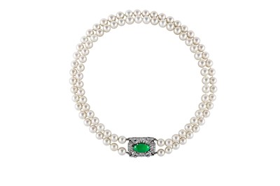 Lot 3 - A cultured pearl necklace and bracelet suite with jade and diamond clasps, circa 1950