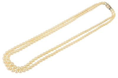 Lot 122-A double-strand cultured pearl necklace by Mikimoto