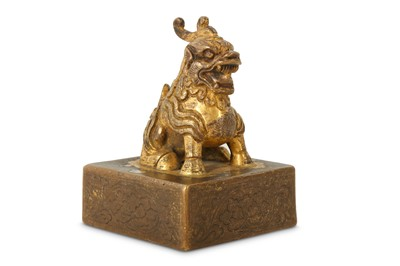 Lot 27-A CHINESE GILT-BRONZE SQUARE SEAL.