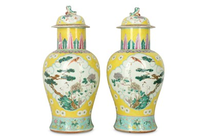 Lot 319 - A PAIR OF CHINESE FAMILLE ROSE YELLOW-GROUND BALUSTER VASES AND COVERS.