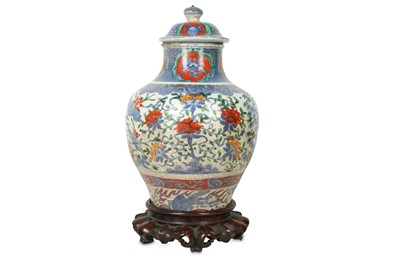 Lot 20-A CHINESE BLUE AND WHITE ENAMELLED VASE AND COVER.