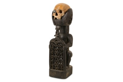 Lot 6-TRIBAL INTEREST: A DAYAK HUMAN SKULL TROPHY ON LATER STAND