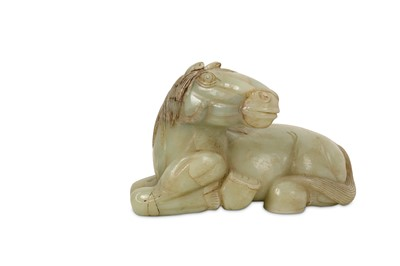Lot 41-A CHINESE PALE CELADON JADE CARVING OF A RECUMBENT HORSE.