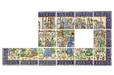 Lot 24-* A LARGE COMPOSITION SET OF THIRTEEN MOULDED POTTERY TILES