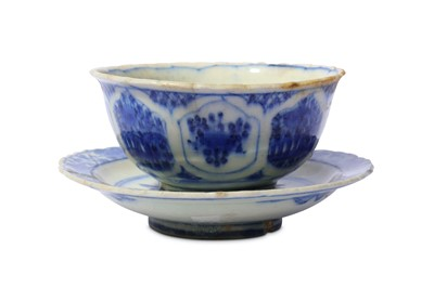 Lot 18-* A BLUE AND WHITE POTTERY BOWL WITH SAUCER