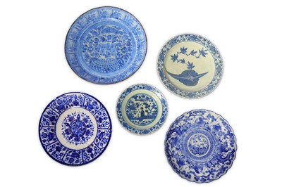 Lot 14-* FIVE CHINESE-INSPIRED BLUE AND WHITE POTTERY DISHES