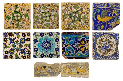 Lot 27-* NINE POTTERY TILES WITH FLORAL DECORATION