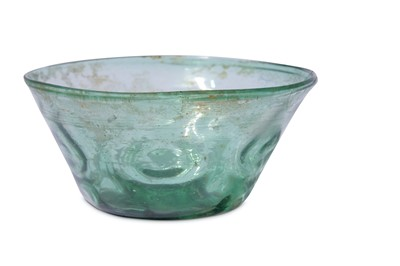 Lot 5-* A SMALL GREEN MOULD-BLOWN CLEAR-GLASS BOWL