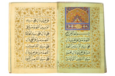 Lot 115 - AN ILLUMINATED BOOK OF PRAYERS ON COLOURED PAPER