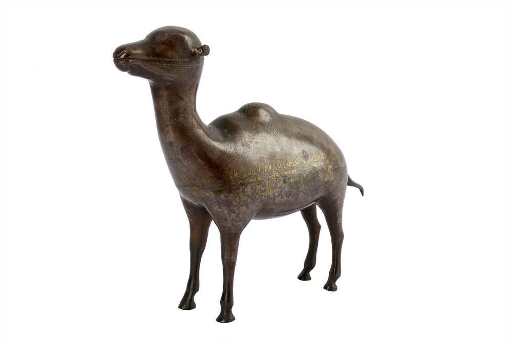 Lot 106 - * A QAJAR GOLD-DAMASCENED STEEL CAMEL