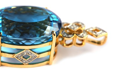 Lot 28-A blue topaz and diamond pendant