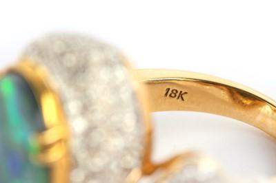 Lot 26-An opal and diamond dress ring