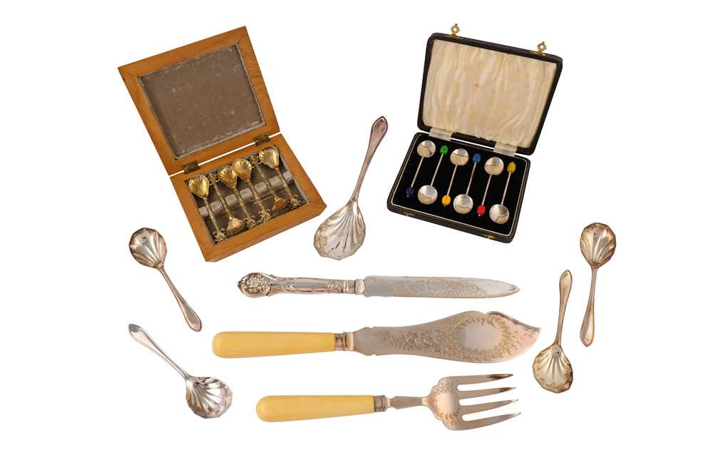 Lot 44-A boxed set of Art Deco sterling silver coffee spoons