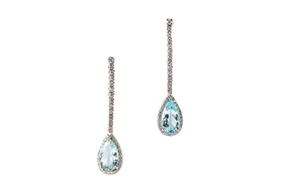 Lot 22-A pair of aquamarine and diamond pendent earrings