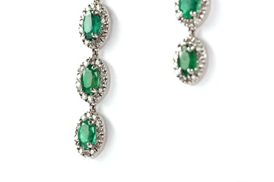 Lot 4-A pair of emerald and diamond pendent earrings