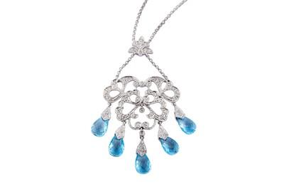 Lot 13-A blue topaz and diamond pendant necklace