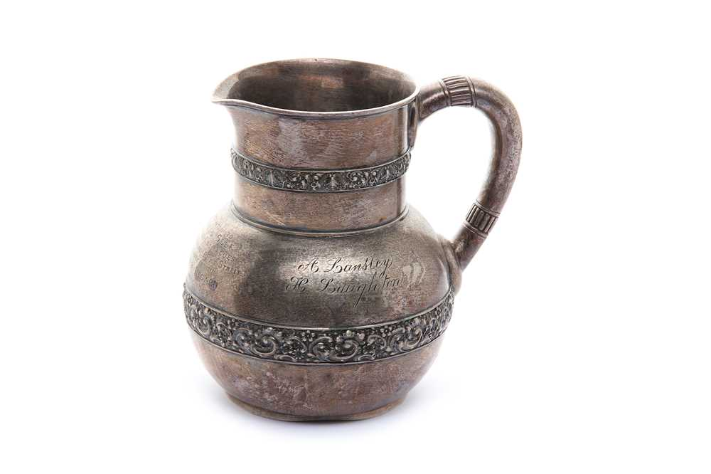 Lot 1-An early 20th century American sterling silver water pitcher by Tiffany