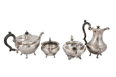 Lot 15-A George V sterling silver three piece tea set