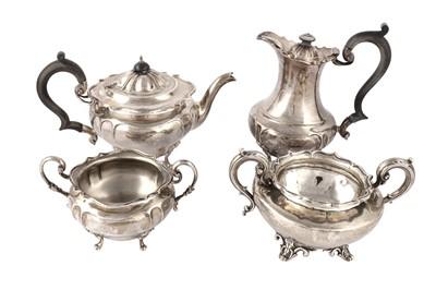 Lot 15-A George V sterling silver three piece tea set