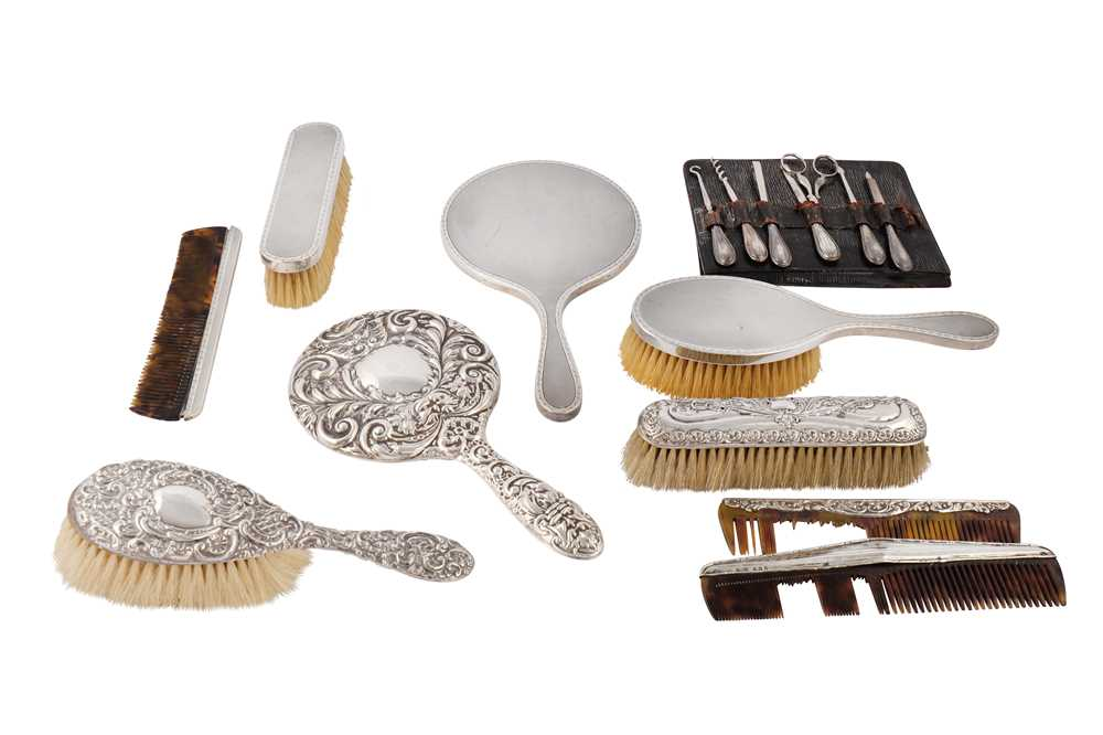 Lot 24-A collection of sterling silver mounted dressing table items