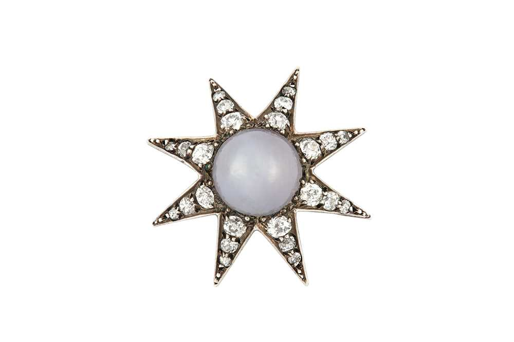 Lot 11-A late 19th century star sapphire and diamond star brooch