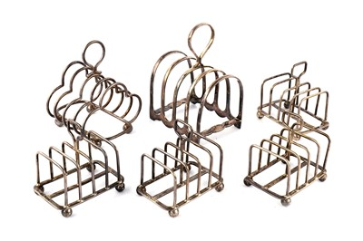 Lot 39-A set of four Edwardian sterling silver toast racks