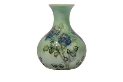 Lot 6-WILLIAM MOORCROFT FOR LIBERTY & CO., a Tudor Rose miniature bottle vase
