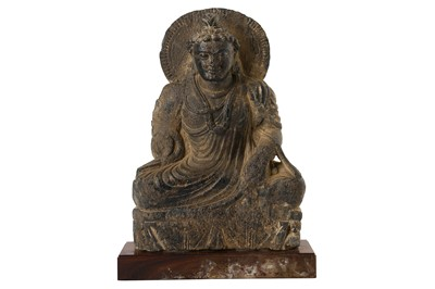 Lot 155 - A CARVED GREY SCHIST SEATED BUDDHA